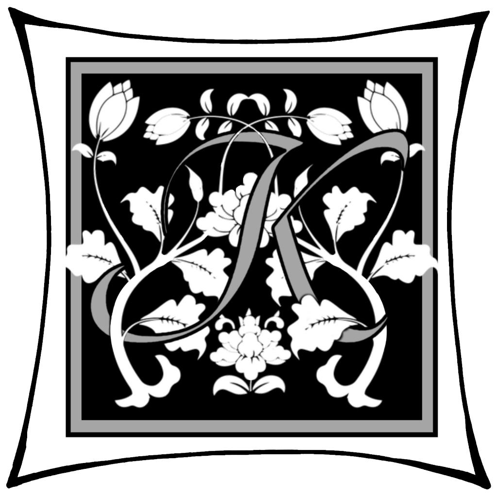 Ein K um dessen Arme Ranken geschlungen sind auf schwarzem Grund und mitgrauen graden Rahmen und darum noch ein weißer eckiger Rahmen.
